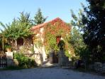 This cozy  stone cottage house, stands in the quiet  nature of the typical Cretan landscape.
