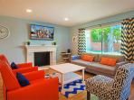 Warm colors, comfy seating, big tv.  This isn't just like home, it's better!