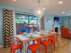 Take advantage of our modern dining room to eat in. Seating for 8 + bar & patio. Service for .