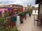 Enjoy the view of Santo Domingo from our rooftop terrace