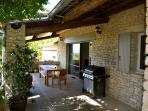 your outdoor dining area with direct access to gourmet kitchen, solid covered for hot summers