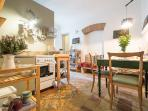 bright and well equiped kitchen and dining room