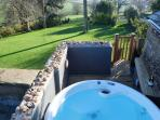 Roof top hot tub - perfect for a relaxing soak or watching the stars at night.
