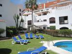 A pool area in La Maestranza. A very popular complex within walking distance of Puerto Banus.