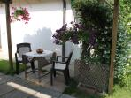 Table In The Garden And The Secondary Entry of VENICE DREAM HOLIDAY APARTMENT