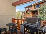 Gas grill and seating on front deck