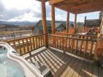 The master bedroom balcony is where you find the hot tub