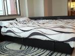 Sofa bed in bed position. Convert to a very comfortable double size bed. Suitable for up to 2 adults
