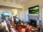 Great room has ocean views, fireplace, HDTV with DVD player, dining table for 6 and another for 4.