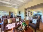 Great room with vaulted ceilings and comfortable furniture.