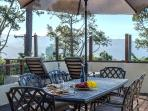Various outdoor seating options with panoramic ocean views.