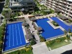 actual photo from balcony, lap pool, wading pool and kids pool,, covered cabanas