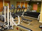 A fully-stocked fitness room lets you keep up with your workouts