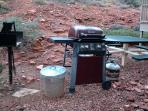 Cook an old-fashioned camp meal on the propane or wood-fired grills