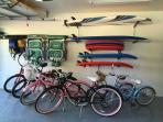 All the beach toys are included in the garage:  Boogie & surf boards, chairs, umbrella and bikes.