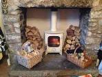 Sitting room - woodburning stove - lovely and cosy, whatever the weather.
