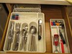 LOTS of silverware (2 trays), corn holders, lobster cracker/forks, bottle/wine openers/stopper, etc.