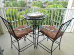 Second bedroom balcony with bistro set where you can see the gulf of mexico