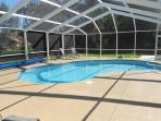 Spacious enclosed pool deck and heated pool