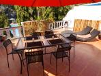 upstairs terrasse with dining table, lounge chairs and BBQ
