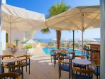 Have your breakfast or coffee at the pool bar!