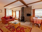 Living/dining room with a log-burner for cosy evenings after a day exploring the Dales