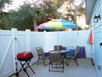 Patio with Patio Table, Chairs, Grill, Beach Chairs and Beach Umbrella