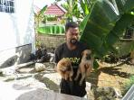 Desroy, the caretaker,  with our new puppies