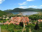 This is Ston; charming little coastal town..our property is situated on a main street Placa.