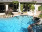 Swimming Pool, Tropical Bar Counter, Spa, and waterfall.