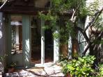Main entrance with mimosa tree