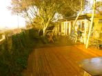 Large decking area with views to sea and Burgh island.