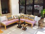 Enjoy this cosy corner of the terrace relaxing on the handmade corner sofa