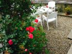 Pretty patio garden, gets the sun all day in summer. Room for barbeque (provided) and sunbeds too!