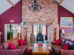 The main lounge with double sided log burner