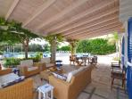 Covered outdoor sitting and dining areas