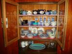 Dining room wall pantry with Blue Willow China.