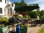 Bright warm sunshine on the patio at The Acre Bwlch.