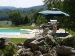 Pool relaxation zone, including doing set, loungers and stainless steel barbecue....