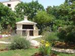 big stone made barbicue in the garden
