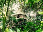 the tree house hiding in a beautiful garden oasis