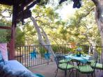 Dining in the Oak Trees on the Upstairs Deck