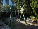 Children can have fun on the swing and in sandbox in our garden