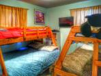 Two bunkbeds with twins above & doubles below, kids books & games, cable, CD player, and boom box