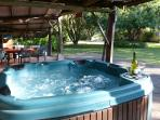Jacuzzi and BBQ area in The Shed at  Daintree Valley Haven