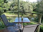 View over the rainforest and lagoon from self-catering cabin at Daintree Valley Haven