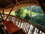 Open air lounge - magical sunrise view across rice terraces towards mount Agung