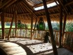 Ground-floor giant lounge area directly facing rice fields and morning sun