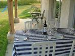 Dining on the gîte's private terrace with a bottle of wine from a local vineyard