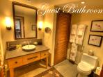 Guest bathroom with deep soaking tub and shower.